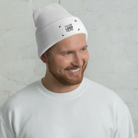 Male model showing the embroidered custom winter hat with a sample logo design