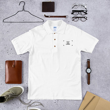 Custom Embroidered polo shirt laying on background