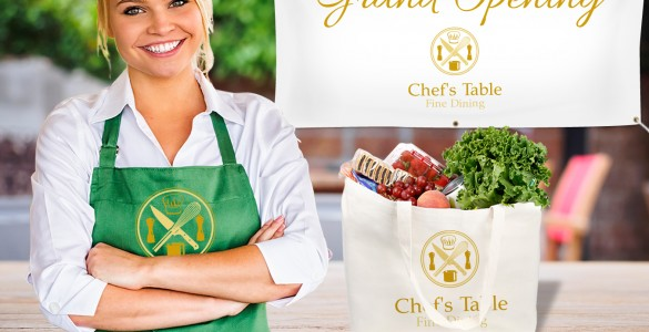 woman wearing branded apron with custom tote bag and banner