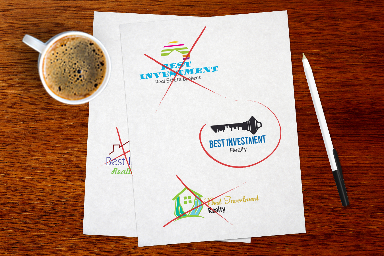 multiple logo designs displayed on paper