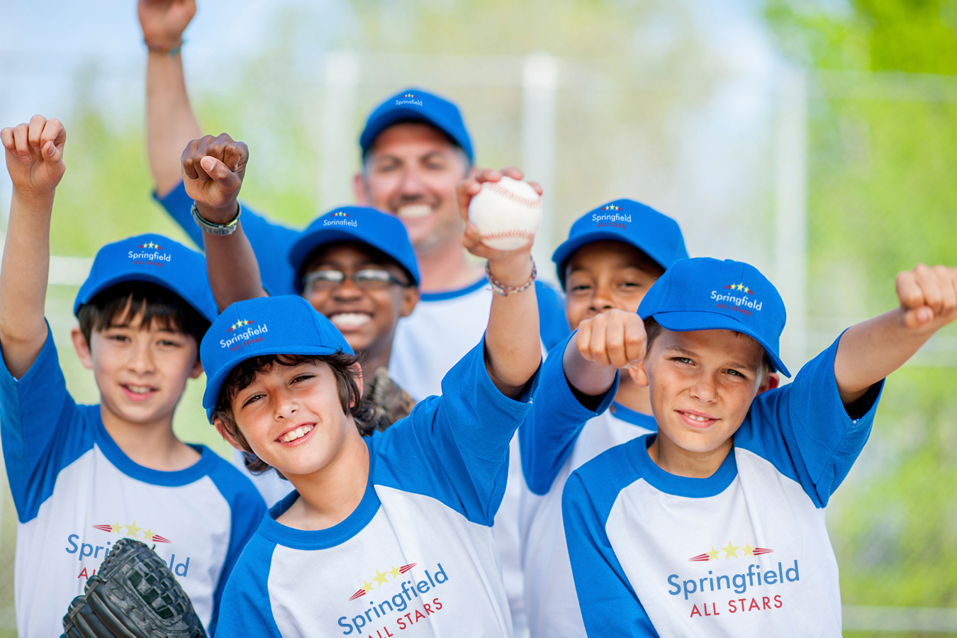 Little League kids in custom t-shirts and hats