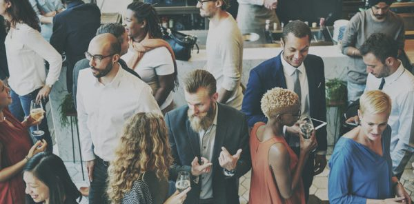 entrepeneurs networking at network event