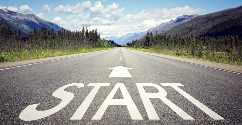 "open road with ""start"" displayed on pavement"