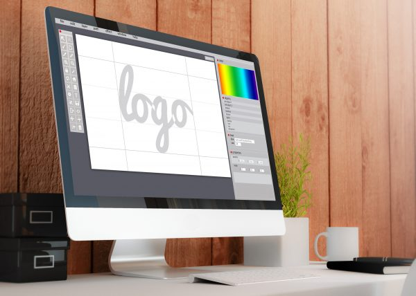 Mac desktop computer with a logo design software on the screen
