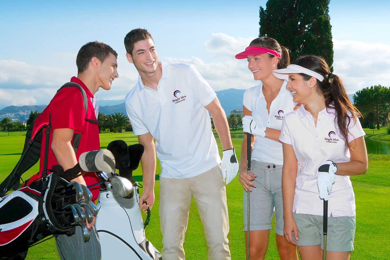 group of young adults golfing and wearing branded polos