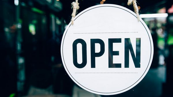 sign saying OPEN hanging in a window