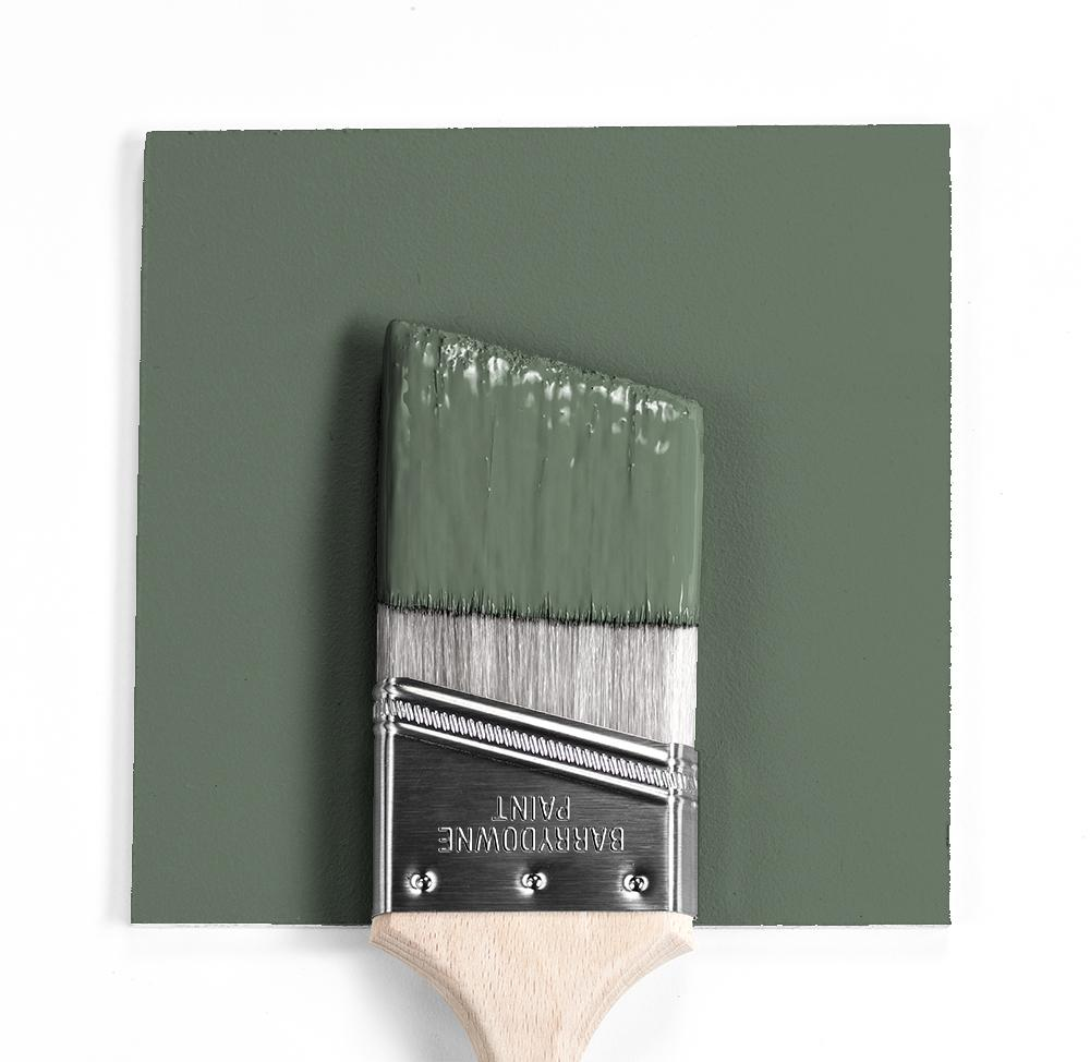 paint brush with dipped in green paint