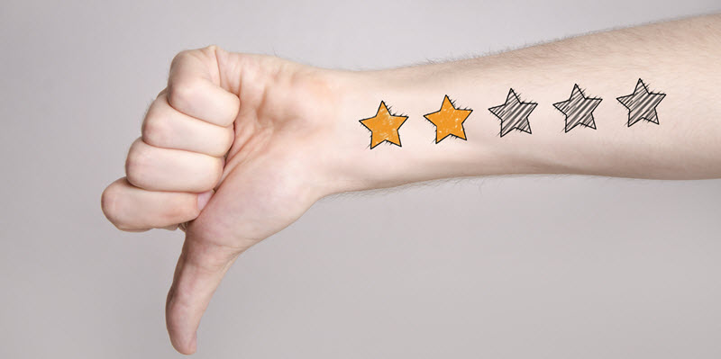 man giving thumbs down with two star review