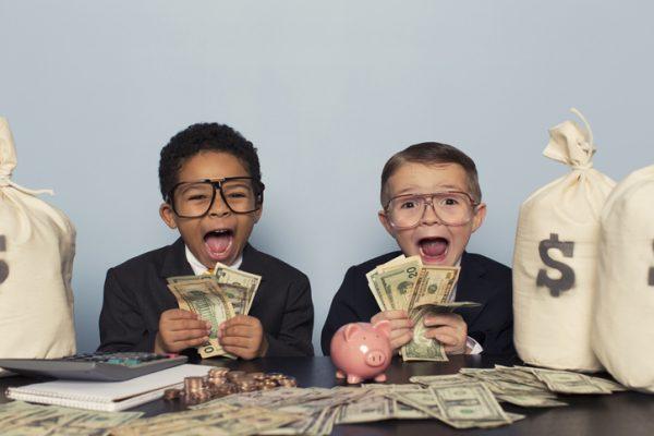 little kids holding money