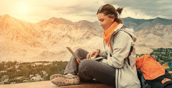 travel blogger on laptop