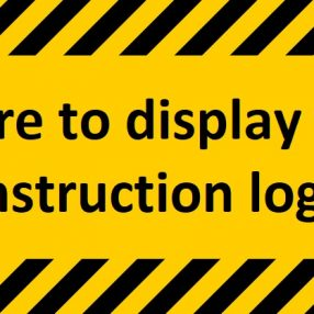 black and yellow construction sign