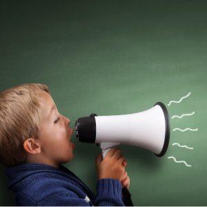Little Boy Yelling through a megaphone