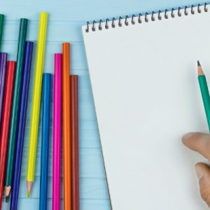 colored pencils and blank white paper